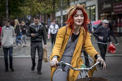 Chakra Khan (Leanne Boulton) Tags: people urban street candid portrait portraiture streetphotography candidstreetphotography candidportrait streetportrait streetlife woman female girl face facial expression mood atmosphere bike cycle cycling tattoo tattoos piercings alternative fashion style bright yellow red hair redhead chakra spirituality tone texture detail depthoffield bokeh motion naturallight outdoor light shade shadow city scene human life living humanity society culture canon canon5d 5dmkiii 70mm character ef2470mmf28liiusm color colour glasgow scotland uk