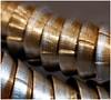 Round and Round (jesse1dog) Tags: macro swarf metalturnings spiral steel olympusmacro50mmf35 oily gm1