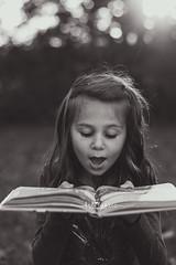 Bookworm (shootwithkat) Tags: childhood bookworm childportrait nikon nikond5200 50mm blackandwhite blackandwhiteportrait glitter reading