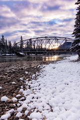 Snow Baubles on the Shoreline (Kristin Repsher) Tags: alberta banff banffnationalpark bowriver bridge canada canadianrockies castlejunction d750 freezing nationalpark nikon rockies rockymountains snow stream sunrise winter