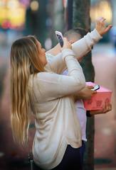 Diamonds & Doughnuts (Ian Sane) Tags: ian sane images diamondsdoughnuts woman engagement ring selfie jewelry store southwest yamhill downtown portland oregon candid street photography canon eos 5ds r camera ef70200mm f28l is usm lens