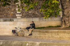 Busker on the banks of the Seine (Aliy) Tags: boattrip seine paris france candid streetphotography busker accordian bike bicycle alone lonely one 1