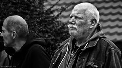 The Bavarians (Neil. Moralee) Tags: neilmoralee neilmoraleenikond7200 bavaria bavarian man men old mature group denim jacket medalion necklace beard moustache german hard tough frightening strong portrait face black white mono monochrome blackandwhite bw bandw oktoberfest beer germany street candid harsh neil moralee nikon d7200 close telephoto zoom powerfull leader gang hood hoodie hoody cropped hair badge