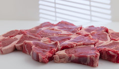 Raw lamb chops. (annick vanderschelden) Tags: lamb sheep cutlet meat thin sliced rib food preparation cuisine cooking raw nutrients fat choppingboard white elasticity gelatine collagene cuts tender tough pig musclefibers connectivetissue water fibers protein structure support bone collagen sturdy juicy temperature molecules bond contraction texture moisture red chops belgium