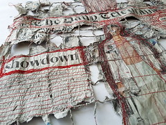 showdown - work in progress (Ines Seidel) Tags: dailytelegraph newspaper rework altered altering alteringthenews news paper sewing redthread fiberart paperart zeitung zeitungspapier text pattern texture muster nähen rot red wip workinprogress