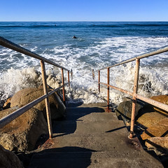 Staircase to the Ocean - The Strand (Sebastian Humphreys) Tags: oceanside thestrand strand stairs pacificocean hightide surfer surfing ocean