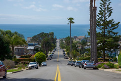 It's all downhill from here. (kirstenscamera) Tags: rollerblading beach road street thoroughfare outside california southerncalifornia socal westcoast palmtrees pacificocean pacific water cars neighborhood houses yellowline ocean 2017