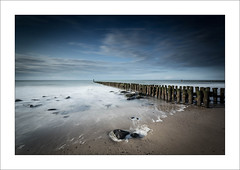Solitude V (Frank Hoogeboom) Tags: nederland westkapelle zeeland holland netherlands water ocean sea long exposure fine art color waterscape seascape blue waves coast shore pier jetty stacks poles