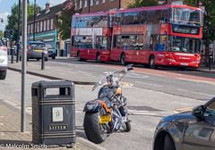 Bike & Buses (M C Smith) Tags: pentax k3ii buses bus red bike custom pavement kerb footway bin draincover shops orange blue silver cars traffic parking chrome bollards post sky white clouds trafficlights