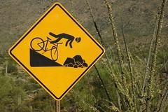 Rider in Peril (VenturaMermaid) Tags: sign signage peril yellow caution warning biker cactus saguaronationalpark humor color stickfigure