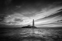 Beacon (hammermad) Tags: blackandwhite black beach sea sunrise seascape sky seaside light lighthouse le clouds coast cloudscape beacon hightide
