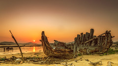xia pu (sandilesmana28) Tags: orange sunrise china xia pu hui an boat abandon shipwrecks sun water landscape beach