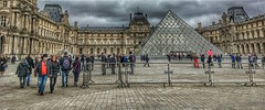 Louvre  - Paris - France  ~   I.M. Pei's glass pyramid in 1989 ~ Courtyard (Onasill ~ Bill Badzo) Tags: he louvre museum historic monument building architecture pyramid glass triangle chinese american i m pei architect courtyard clouds sky city paris france landmark history largest onasill seine river mustsee travel tourist french central pano panorama site europe