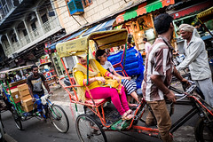 . (superUbO) Tags: india delhi risho cycle transport pass city old colors woman moment street way travel reportage traffic people looks culture life cross