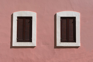 Two windows in a pink wall