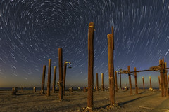 Star Trails Above Pilings at the Remains of the Salton Sea Navy Test Base (slworking2) Tags: saltoncity california unitedstates us navy desert lake pilings pier decay urbex stars startrails starstax