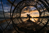 Caught in a Net (Trent's Pics) Tags: fishingnet inlelake inthafisherman boat buddhist clouds fish fisherman fishing ice intha lake landscape lifestyle myanmar net people spiritual sunset water