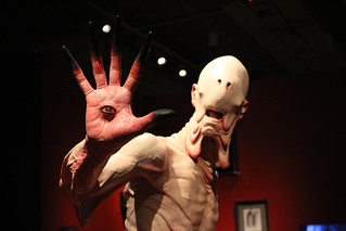 The Pale Man from Pan's Labyrinth has an eye on everyone who enters At Home with Monsters. Photo © Amy Bae.
