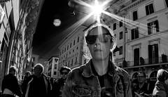 Almost angelic! (Baz 120) Tags: candid candidstreet candidportrait city candidface candidphotography contrast street streetphoto streetcandid streetphotography rome roma romecandid romestreets em5 europe mft m43 monochrome mono blackandwhite bw urban samyang75mmfisheye life primelens portrait people unposed olympus omd italy italia girl grittystreetphotography flashstreetphotography decisivemoment strangers