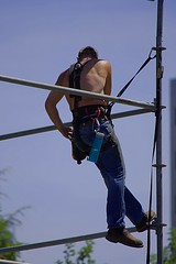 Assembling Scaffolding (swong95765) Tags: man work scaffold tether tethered heights assembly guy shirtless