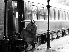 A pending departure (Elenovela) Tags: rain regen regencape raincape capedepluie bahnhof station gare blackandwhite schwarzweis