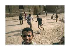 Life in the city of the dead. ( Cairo ) (José Luis Cosme Giral) Tags: lifeinthecityofthedead children football travel street portrait nikon scanned cairo egypt