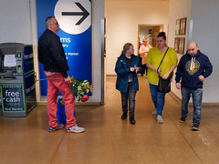 #18 waiting to surprise her (watcher330) Tags: cardiff ikea men women flowers
