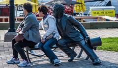 2017 - Charlottetown - Waterfront Bronze (Ted's photos - For Me & You) Tags: canada charlottetown cropped nikon nikond750 nikonfx pei tedmcgrath tedsphotos vignetting sculpture bronzesculpture publicart tophat seating seated sitting denim denimjeans 2017 charlottetownpei princeedwardisland handbag legs