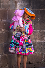 A beautiful young woman in very traditional dress in Cusco city.