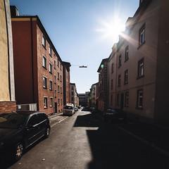 Urban Sunpath (Thomas Listl) Tags: thomaslistl color square light sun sunlight shadows contrasts würzburg grombühl street urban red orange blue wideangle ultrawideangle 14mm houses cars october