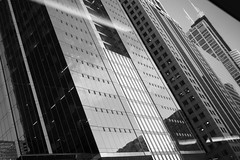 backslash \ adjusting the grid (KevinIrvineChi) Tags: willistower sears wacker n north from bus window glass steel skyscrapers canyon wall office buildings architecture som sony dscrx100 bnw bw black white blackwhite blackandwhite blanc noir downtown urban curbedchicago chicago illinois loop shiny reflective reflections outdoors outside glassy lights afternoon fall autumn 2017