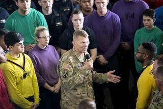 Army Lt. Gen. Jeff Buchanan speaks to the crew of USS Kearsarge in the ship's hangar bay.