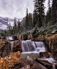 In the Footsteps of Giants (Kristin Repsher) Tags: alberta autumn banff banffnationalpark canada canadianrockies d750 giantsteps longexposure mountains nikon nisi10stopfilter paradisevalley rockies rockymountains snow waterfall