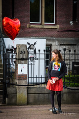 Girl @ Moco Museum (Amsterdam) (PaulHoo) Tags: nikon d750 2017 people candid streetphotography amsterdam city urban citylife holland netherlands moco museum bansky red color girl popart andy warhol