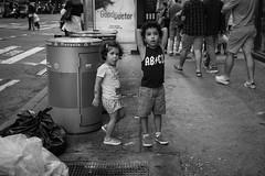 NYC Kids. (Livia Lopez) Tags: nyc newyorkcity newyork manhattan timessquare street sidewalk urban boy girl monocrome canon photography children city calle callejero urbano niña niño monocromo fotografia ciudad gente