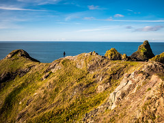 Higher and higher... (davYd&s4rah) Tags: cornwall england southengland green colors coast sea ocean europe uk sky clouds autumn herbst rock mountains felsen klippen cliff landscape vista view olympus m1240mm f28