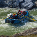 Rafter rowing through Sheep Slot Rapids on Firth River, Ivvavik National Park, YT