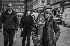 When The Wind Blows (Leanne Boulton) Tags: people portrait urban street candid portraiture streetphotography candidstreetphotography candidportrait streetportrait streetlife woman female girl face facial expression look emotion feeling mood atmosphere weather wind windy hood autumn blonde movement tone texture detail depthoffield bokeh naturallight outdoor light shade shadow city scene human life living humanity society culture canon canon5d 5dmkiii 70mm character ef2470mmf28liiusm black white blackwhite bw mono blackandwhite monochrome glasgow scotland uk