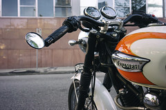 Triumph on Homer (Eric Flexyourhead) Tags: vancouver canada britishcolumbia bc downtown homerstreet city urban detail fragment motorcycle motorbike bike british triumph tank fueltank sonyalphaa7 zeisssonnartfe35mmf28za zeiss 35mmf28