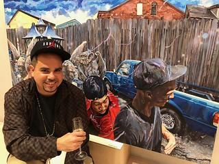 Artist Michael Vasquez with his artwork at The New World School of the Arts alumni fundraiser at Faena Forum