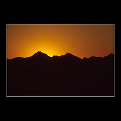 The Torn Apart Photograph (KoenK68) Tags: sundown mountains hills backlight orange red yellow light canon arizona az ©koenk68
