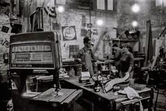 Craft Decisions (Ren Eve) Tags: hipster hip marigny neworleans louisiana indoor conversation light people wood craftsman saw craft shop work studio blackandwhite bw film