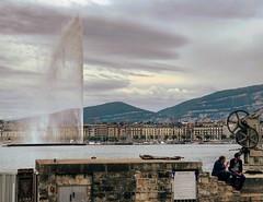 Rive droite (Eric_G73) Tags: jetdeau fountain lake mountains geneva switzerland street people streetphotography genève sky clouds skyline