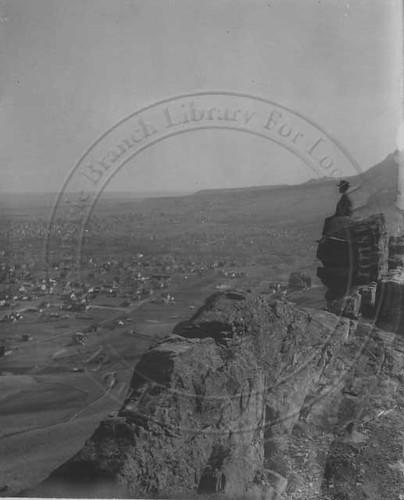 Photo - Man on rock overlooking Boulder From Mt. Sanitas (1908).