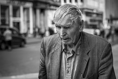A Rough Day (Leanne Boulton) Tags: portrait urban street candid portraiture streetphotography candidstreetphotography candidportrait streetportrait closeup streetlife old elderly man male face facial expression look emotion feeling mood bedraggled rough hair tone texture detail depthoffield bokeh naturallight outdoor light shade shadow city scene human life living humanity society culture people canon canon5d 5dmkiii 70mm character ef2470mmf28liiusm black white blackwhite bw mono blackandwhite monochrome glasgow scotland uk