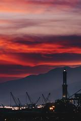 Sunset on the Lighthouse (FButzi) Tags: genova genoa liguria italia italy lanterna simbolo sunset sky red clouds light dusk faro lighthouse lantern porto port