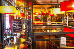 find the photographer (albyn.davis) Tags: restaurant colorful bright colors vivid vibrant red yellow lights light lighting people photographer reflection mirror paris france europe winter