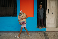 Havana, Cuba (f.d. walker) Tags: americas cuba habana havana lahabana latinamerica northamerica woman man people bag carry carrying groceries milk milkpowder candidphotography candid color colorphotography clothes city colors funny strange streetphotography street humor