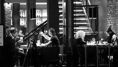 dining after dark 02 (byronv2) Tags: edinburgh edimbourg scotland blackandwhite blackwhite bw monochrome newtown saintandrewssquare edinburghbynight night nuit nacht dining restaurant window peoplewatching candid street eating