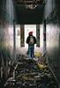 Golden (Katie Tarpey) Tags: film 35mm abandoned abandonedbuilding rubbish trashed broken neglect forgotten light hallway nikonfm10 nikkor50mm14 agfa agfavistaplus400 goldbackpack derelict converse